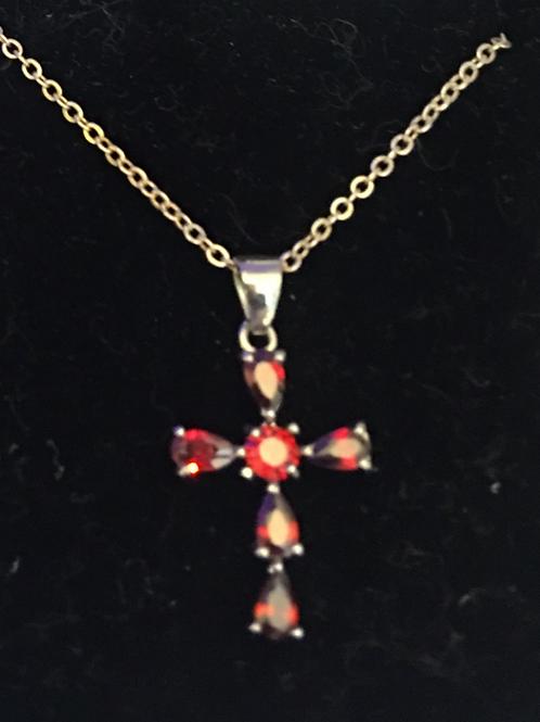 A Ruby Cross Set in Sterling Silver