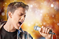 Young boy with microphone on white backg