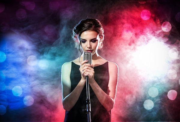 Young woman with microphone and colorful