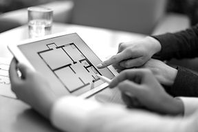 Real-estate agent showing house plans on electronic tablet_edited.jpg