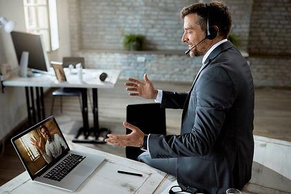 happy entrepreneur using laptop and havi