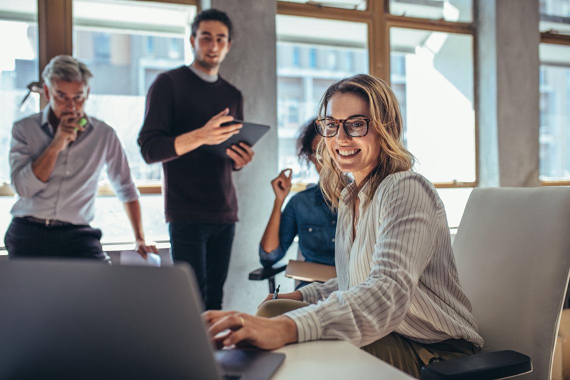 Female entrepreneur working on laptop an