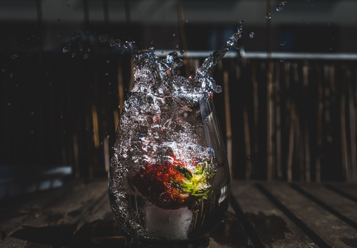 Strawberry dropping in a glass