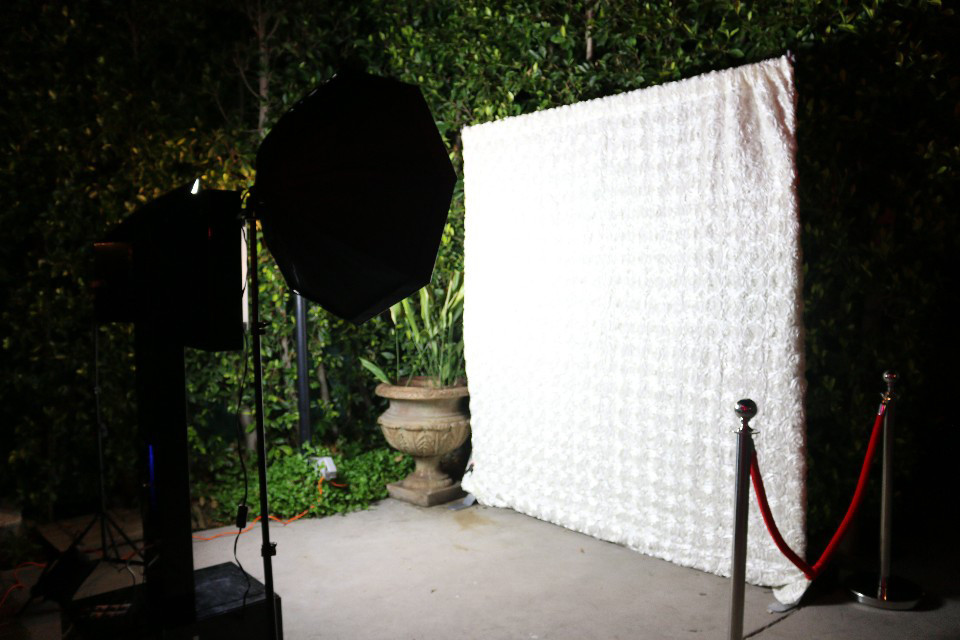 Open Air Photobooth with white roses backdrop