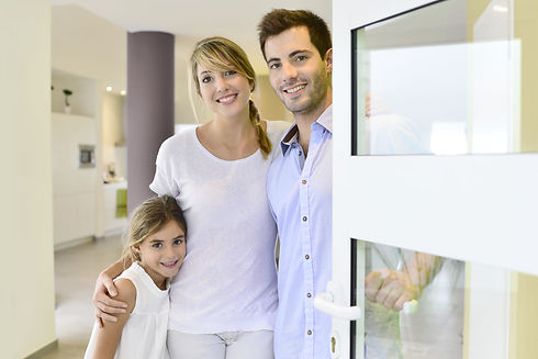Family standing at front door to invite