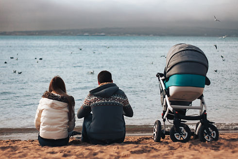 a seed couple with a stroller for a chil