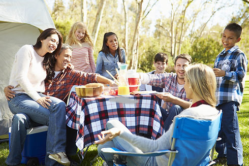 Two Families Enjoying Camping Holiday In