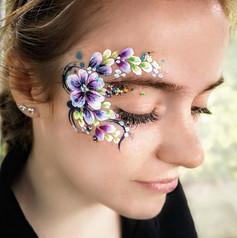 Flower eye design face paint