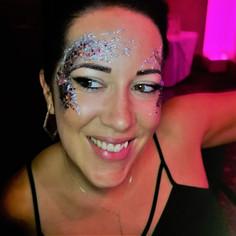 Wedding guest with glitter face art