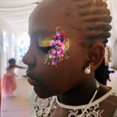 Gold eye design - girls face painting