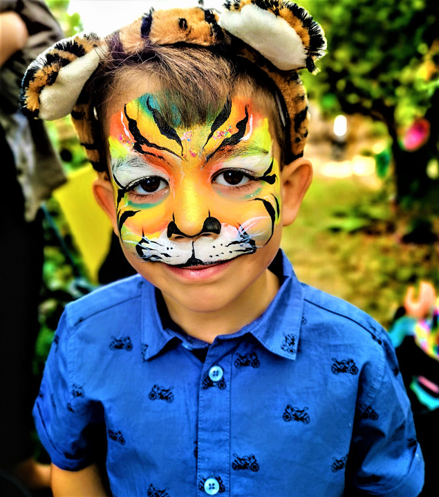 Boys tiger face painting - store opening event