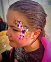 whimsical floral eye design face paint