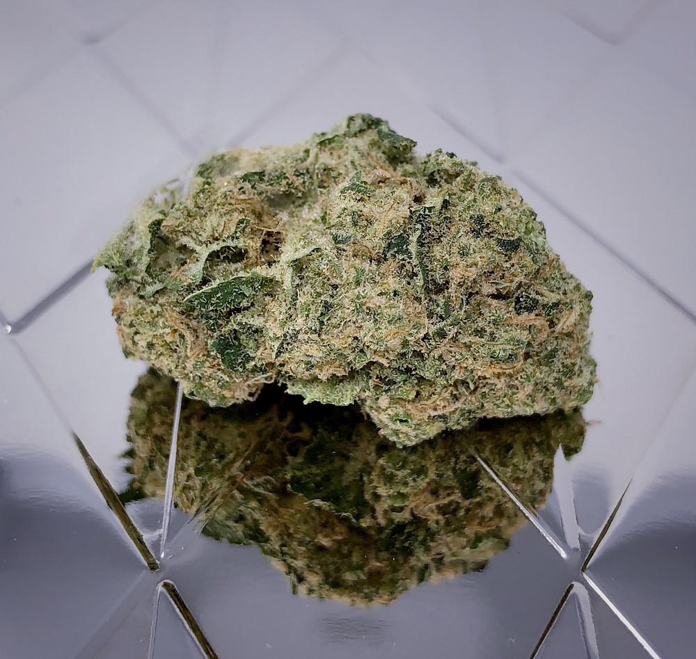 Close-Up of Marijuana Nug with Reflective Background