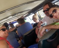 St. Lucia tour bus with 13 people in a van for 12.