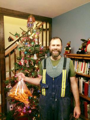 Patrick with his December Carrot Harvest