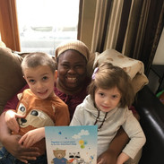 Caregiver Iesha with Patient Theodore and Cora
