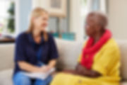 Female Support Worker Visits Senior Woma