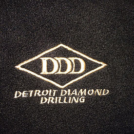 DDD Logo white on blk from coatIMG_1763.