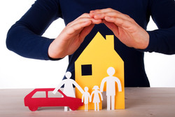 Hands Protecting House, Family And Car