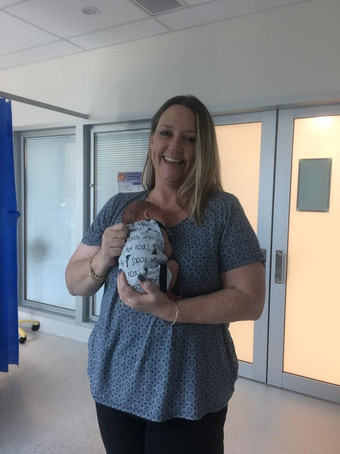 Nanna-holding-her-grandson-born-premature-at-32-weeks-at-fiona-stanley-hospital-NICU-weighing-1.8kg