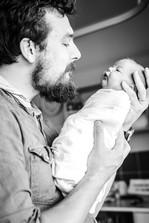 Dad-admiring-his-newborn-son-Perth-Fresh-48-Photographer