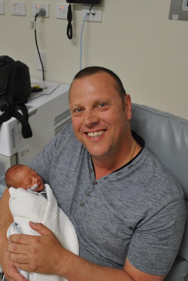 grandad-holding-his-grandson-born-premature-at-32-weeks-at-fiona-stanley-hospital-NICU