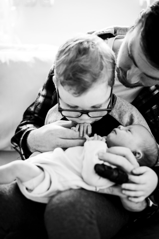 Big-brother-giving-his-baby-sisters-hand-a-gentle-kiss-Perth-Fresh-48-Photography