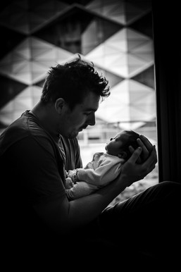 Dad-cradling-his-newborn-son-in-the-window-Perth-Fresh-48-Photographer