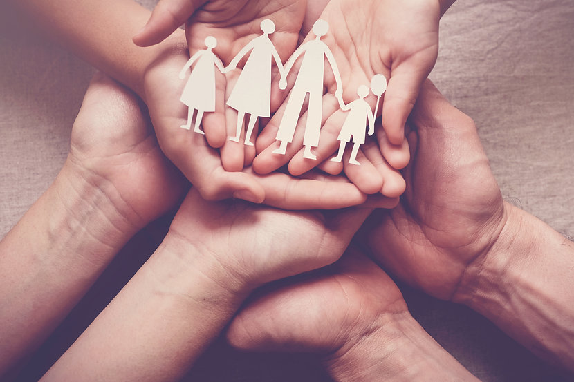 hands holding paper family cutout, famil