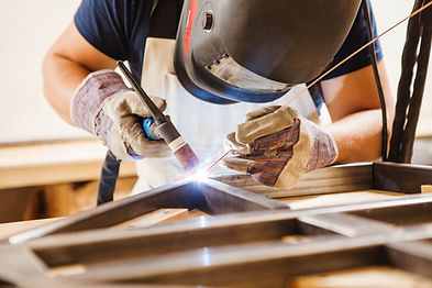 Winning business is an art. Picture of a craftsman welding metal.