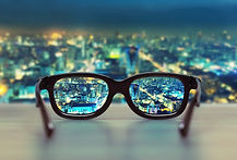 Night cityscape focused in glasses lense
