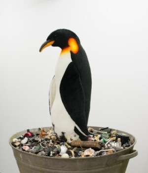 Mark Dion, Emperor Penguin, 2016  sink bucket - wooden crate - tar - various trinkets and costume jewellery, 100x75x115cm (crate 110x90x78cm)