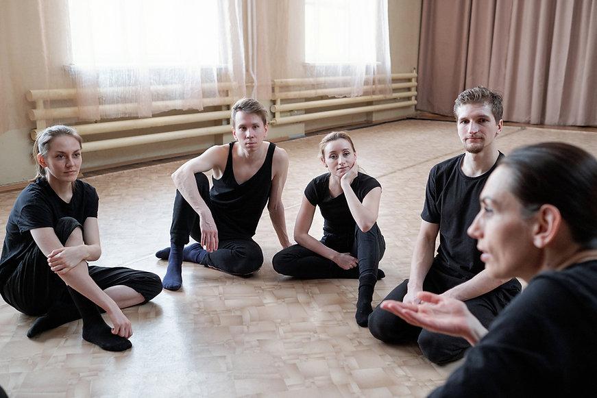 Group sitting on studio floor shuttersto