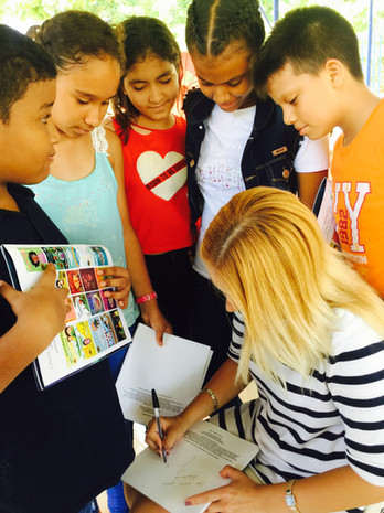 Jazmín Chi signs book for children in Colombia
