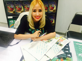 Jazmín Chi signing book at the International Children and Youth Book Fair