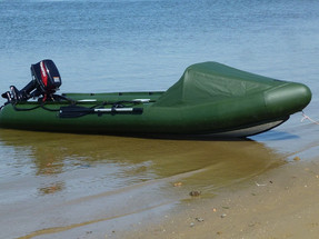 Spearfish motor canoe on the shore