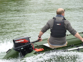 Person motoring a Spearfish inflatable on a river