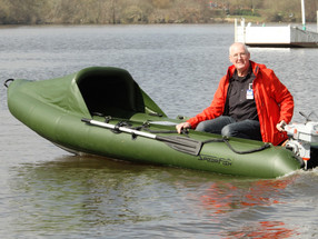 Man smiling using his inflatable dinghy