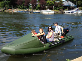 Family of four in inflatable dinghy