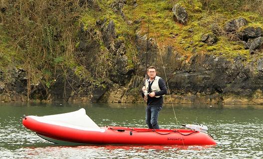 Man stood up on SPearFish boat fishig