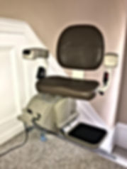 Stair lift at the top of staircase
