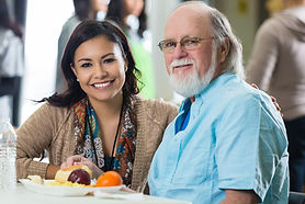 Elderly man and his caregiver