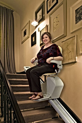 Woman Sitting on a Sraight Stairlift