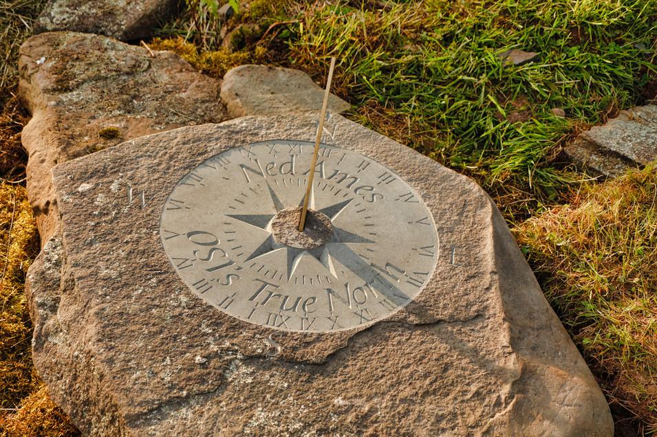 Sundial carved in natural bluestone capstone