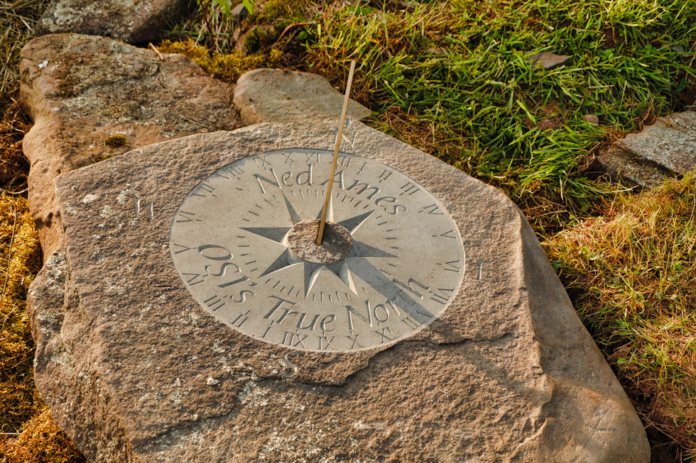 Sundial carved in natural bluestone capstone