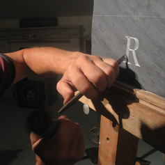 Chiseling a letter