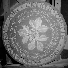 Carved Ginseng with raised uncial lettering