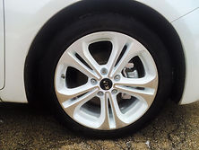 white powder coated rims.  whited out car