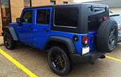 2015-2016 jeep wrangler with black powder coated rims.  Black gloss powder coat