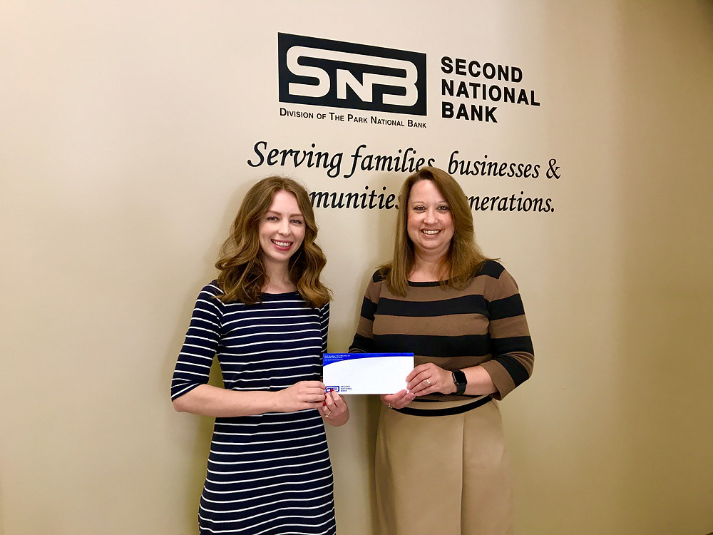Joy Greer, Vice President & Retail Banking Administrator presents the donation to Crysta Hutchinson Bloomingdale, Executive Director of Main Street Greenville.